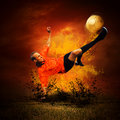 Footballer  in fires Stock Photography