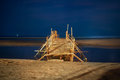 Footbridge on beach at night Stock Image