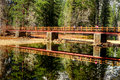 Footbridge merced river yosemite valley national park california in autumn Stock Photos