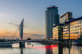 Footbridge at sunset modern salford quays manchester uk Stock Images