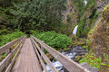 Footbridge to wahclella falls wooden in columbia river gorge oregon Royalty Free Stock Image