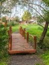Footbridge wooden over the creek in the park Stock Image