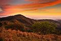 Foothills of Monteverde Cloud Forest Reserve, Costa Rica. Tropic mountains after sunset. Hills with beautiful orange sky with clou Royalty Free Stock Photo