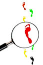 Footmark colorful magnifying glass looking for footsteps Royalty Free Stock Photos