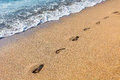 Footmarks on the sandy beach Royalty Free Stock Photo