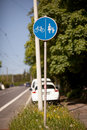 Footpath and cycling road sign european style at roadside Stock Photo