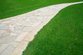 Footpath on grass Royalty Free Stock Photo
