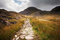 Footpath in landscape to mountains in Snowdonia Stock Photo
