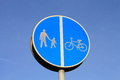 Footpath left, cycle-lane right sign. Royalty Free Stock Photo