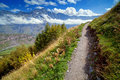 Footpath in mountains travel background green grass white clouds sunny day Royalty Free Stock Photos
