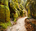 Footpath sandstone rocks ancient autumn carved between high in the fall Royalty Free Stock Photos