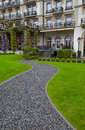 Footpath to the hotel entrance gravel and lawn in garden vertical image Royalty Free Stock Images