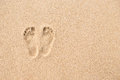 Footprint on beach in sand background Royalty Free Stock Photo