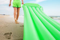 Footprint on sand - boy with swimming mattress walks on the sand