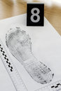 Footprint shoe protector disclosed during the examination Royalty Free Stock Photos