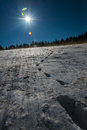 Footprint on snow  and blue sky with Sun flare Royalty Free Stock Photo
