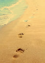 Footprints on beach - vintage retro style Stock Photo