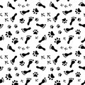 Footprints of human cat dog birds black and white seamless pattern vector background Stock Photography