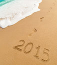 2015 and footprints on sand beach Royalty Free Stock Photo