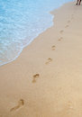 Footprints on sand of sea beach Royalty Free Stock Photos