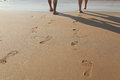 Footprints in wet sand Royalty Free Stock Photo