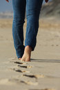 Foots in the sand Royalty Free Stock Photo