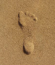 Footstep on sand at the beach in summer Stock Photos