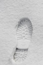 Footsteps in the snow, boot mark close up outdoor Royalty Free Stock Photo