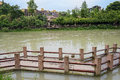 Footway for visitors in river a with stone posts and wooden handrails the chengdu china Stock Images