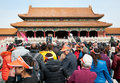 Forbidden city in beijing china – march th a large group of chinese tourists waiting for pass through the gate of supreme Royalty Free Stock Photo