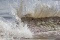 Force of nature. Splashing wave energy. Splash as sea water hits