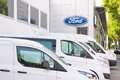 Ford dealership with lots of white cars infront of it copy space to the left of the logo Royalty Free Stock Image