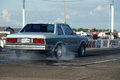 Ford fairmont napierville dragway august rear side view of blue on the race track making a burnout at john scotti all out event Stock Photos