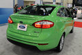 Ford fiesta at auto show rear side new green se sedan on display miami international lights turned on view Stock Photo