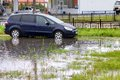 Ford focus s max novyy urengoy russia september black at the city street during a strong flood Royalty Free Stock Photo