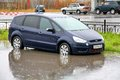 Ford focus s max novyy urengoy russia september blue at the city street during a strong flood Stock Photos