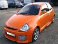 Ford ka a customised orange car with full sports body kit and alloy wheels Royalty Free Stock Photo