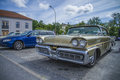 Ford mercury park lane beautifully restored classic american car the photo is shot at the fish market in halden norway Royalty Free Stock Photos