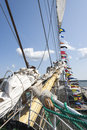 Fore of a sail ship with many tightropes and small flags Royalty Free Stock Images