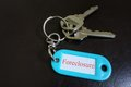 Foreclosure closeup of house keys and keychain with text Stock Photography