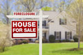 Foreclosure home for sale sign in front of house red real estate Royalty Free Stock Image