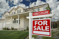 Foreclosure Home For Sale Sign & House Royalty Free Stock Photography
