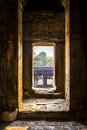 Foregone doorway in the ancient temple ruins of angkor wat cambodia Royalty Free Stock Photo