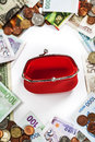 Foreign coins and banknotes frame with red purse money background Stock Photography