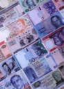 Foreign currencies notes arranged together Royalty Free Stock Photo