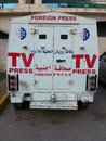 Foreign press vehicle back of television car Royalty Free Stock Photos