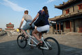 Foreigners riding bicycle on the ancient city wall in xian