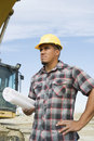 Foreman With Blueprint At Site Stock Images