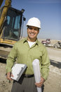 Foreman With Clipboard And Blueprint At Site Royalty Free Stock Photo