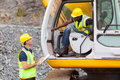 Foreman excavator operator cheerful construction talking to Stock Photos